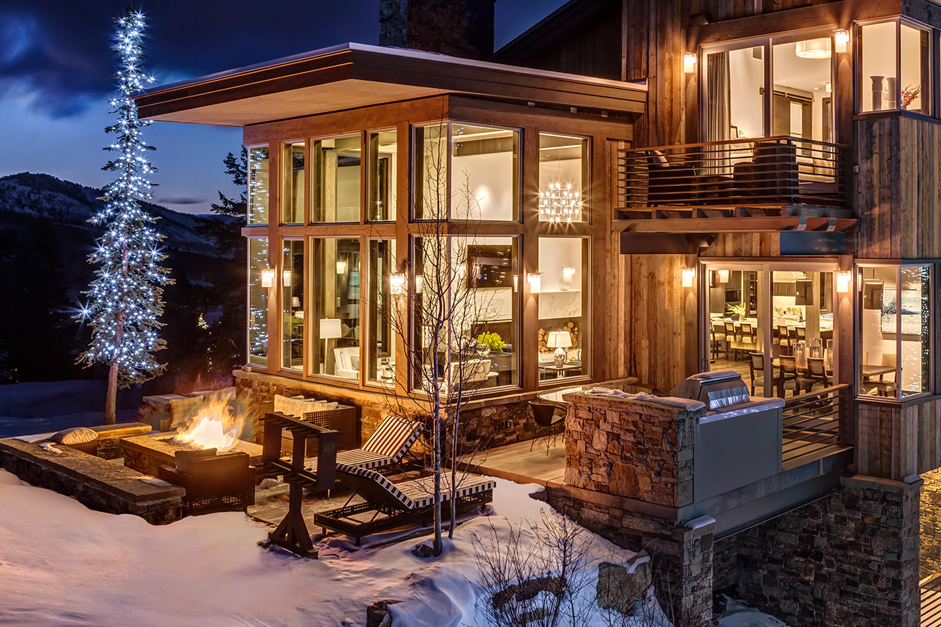 Exterior of Deer Valley ski in ski out house rental with firepit, outdoor grill set on Deer Valley Resort's ski runs
